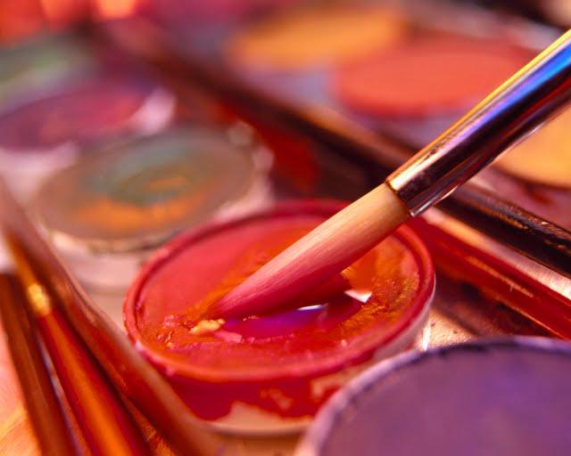 dipping-brush-into-paint-closeup-photo-92707